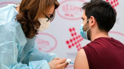 A health worker in Bosnia receives a Covid-19 vaccine