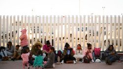 Asylum seekers wait outside the El Chaparral border crossing port hoping to cross into the United States