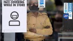 A security guard wears a mask inside a store in New Delhi, India