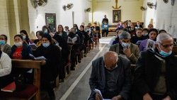Iraqi Christans attend a prayer service at the Syriac Catholic Church in the town of Qaraqosh in Niniveh province, Iraq