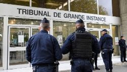 Policemen guard the Evry criminal courthouse in France