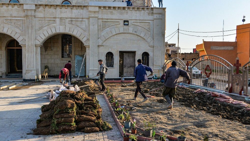 Iraqi workers perform maintenance work in the al-Tahira al-Kubra church (the Grand Immaculate Church) ahead of the Pope Francis visit to the church at the Assyrian town of Qaraqosh, some 13 km east of Mosul, northern Iraq,