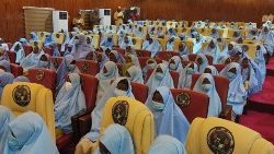 Schoolgirls who had been kidnapped from their boarding schools arrive at the Government House in Gusau, Zamfara State, following their release