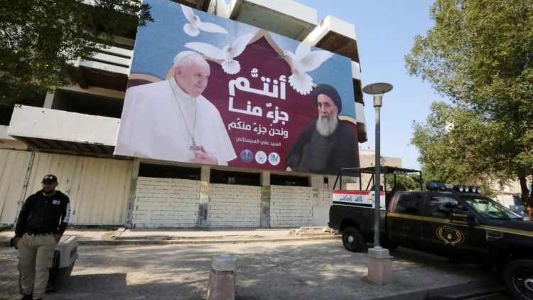 A billboard in Baghdad depicts Pope Francis and Ayatollah Al-Sistani
