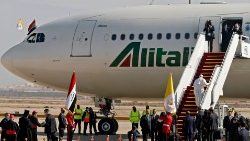 Pope Francis boards an Alitalia aircraft as he departs from Iraq on Monday morning