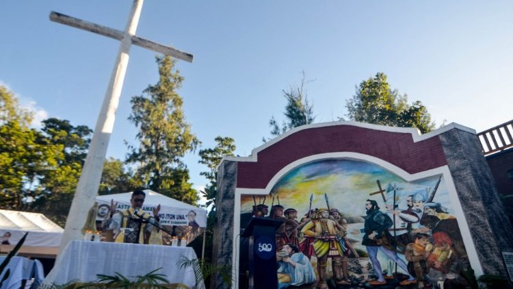 Another Mass was held at the foot of a giant cross on Homonhon island