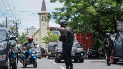 Indonesian police in Makassar after a suicide bombing at a Cathedral