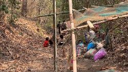 A Karen family taking shelter in the forest in Dooplya district in Myanmar's Karen state.
