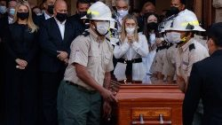 Relatives mourn over the coffin of the former governor of Jalisco state who was murdered in December 2020
