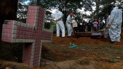 A coffin of a coronavirus victim is buried in a cemetery in Sao Paulo, Brazil