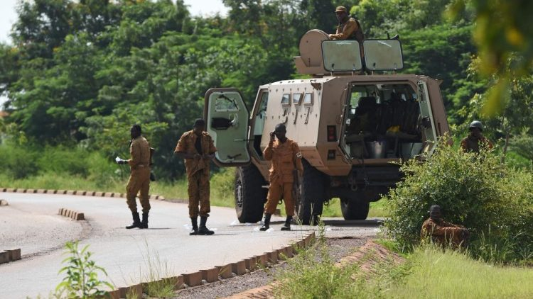 Burkinabe soldiers patrol roads to contain the spread of violence