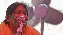 A woman breathes with the help of an oxygen mask in Ghaziabad
