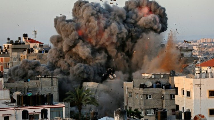 A ball of fire and smoke erupts from a building in Gaza city on Sunday amid bombardment from Israeli forces