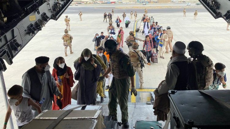 Spaniards and Afghanis board a Spanish Air Force flight out of Afghanistan