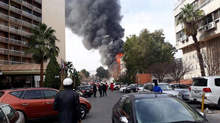 Flames and smoke rise after a mortar shell exploded near to the old Damascus fairground