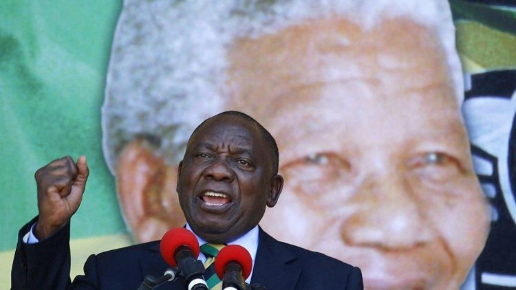 New South African President Cyril Ramaphosa addresses his supporters during a ceremony to mark 100 years from Mandela's birth