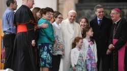 Pope Francis poses with Irish families during a general audience in St Peters Square
