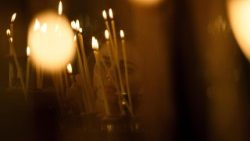 Candles lit in prayer in an Orthodox church in Bulgaria