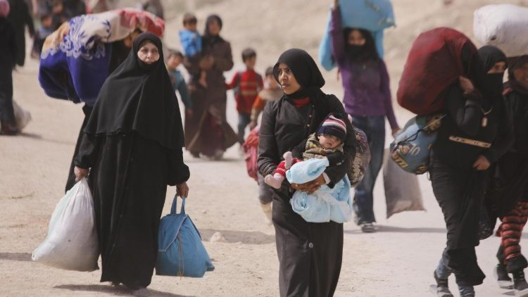 Siria. Civiles huyendo de la guerra.
