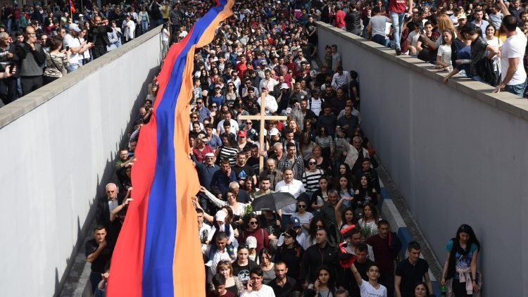 Armenians carry a giant flag at a commemorative march in Yerevan, Armenia