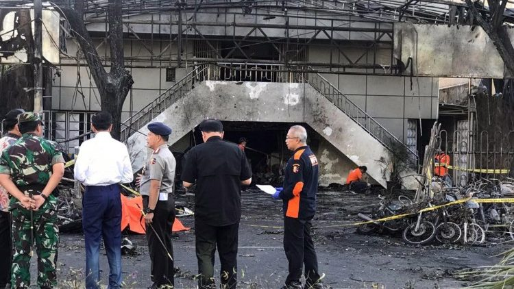 Officials inspect an Indonesian church after it was bombed on Sunday morning