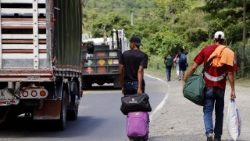 Venezuelan citizens walk on the Curcuta - Pamplona road in Colombia after fleeing hardship in their country