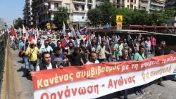 Greeks march in Thessaloniki during a general strike called by labour unions