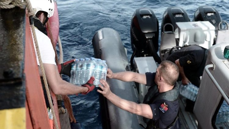 The Aquarius rescue ship takes on supplies after picking up 629 migrants near Libya