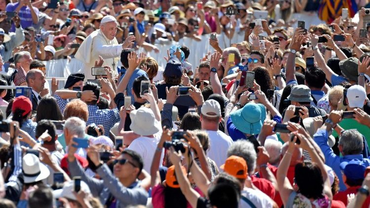 Pope Francis' greeting the crowd gathered in St Peter's Square for the weekly General Audience