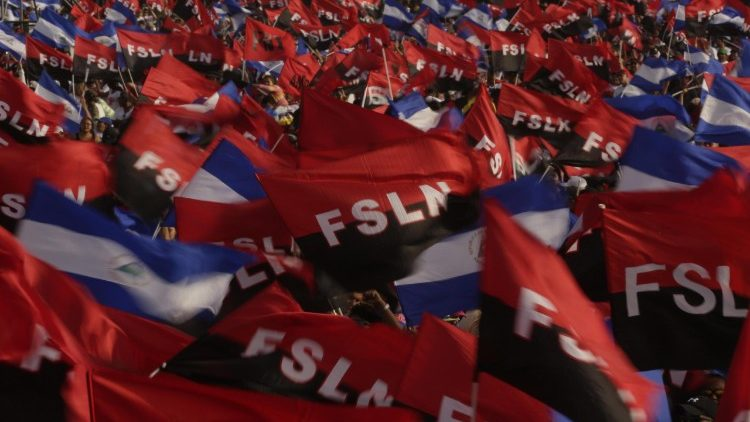 Sandinista sympathizers wave FSLN flags at an anniversary celebration