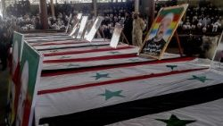 Druze clerics and citizens attend a funeral ceremony for victims of the attacks that targeted the al-Sweida province in Southern Syria