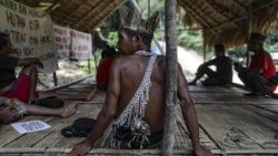 Temiar tribe guard the entrance to their hut during protests against logging on their land, Gua Musang, Malaysia