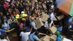 Relief material being distributed to flood-affected people in the Philippine capital, Manila.