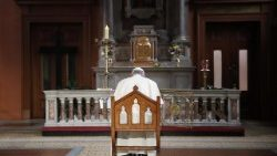 pope-francis-prays-in-front-of-a-candle-lit-t-1535211416743.jpg