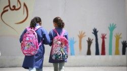 Palestinian refugees heading to an UNRWA funded school in Jordan
