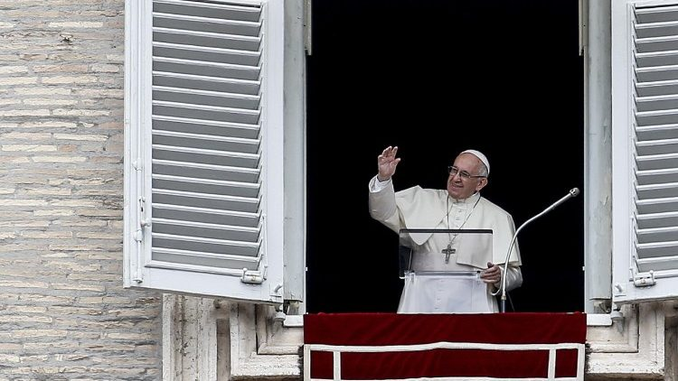 Pope Francis greets the crowds gathered in St. Peter's Square for the Sunday Angelus