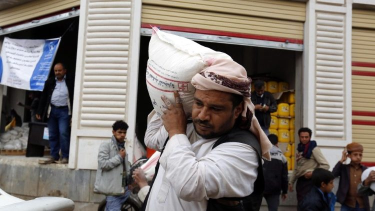 A Yemeni receiving UN food aid in Sana'a, Yemen.