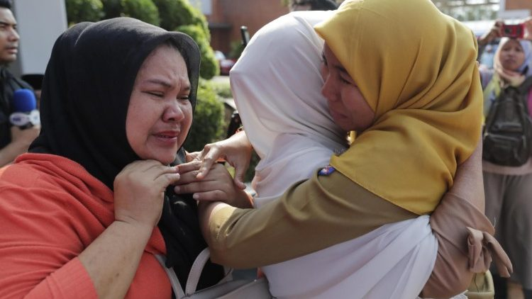 Relatives of victims of Indonesia's plane crash mourning their loved ones.