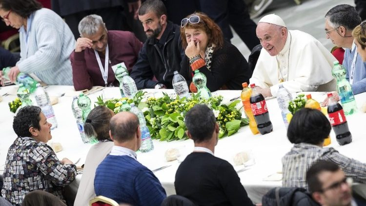 Pope Francis has lunch with people in need