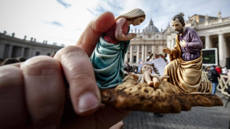 A member of the faithful holds a statuette of the Holy Family at Pope Francis' Angelus address on Sunday