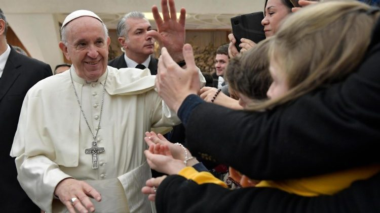 Pope Francis greets pilgrims at a General Audience