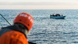Migrants at sea attempting to cross the Mediterranean between Libya and Europe