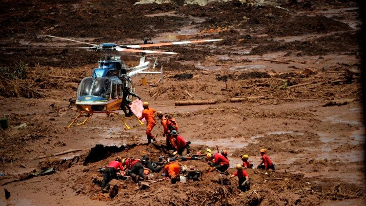 firefighters-search-for-survivors-after-dam-a-1548689629422.jpg