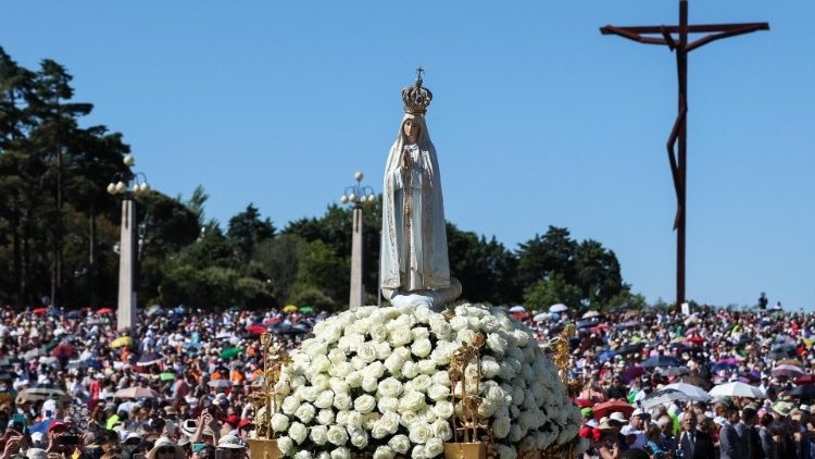 The figure of Our Lady of Fatima is carried in a procession during the 13 May pilgrimage in 2019