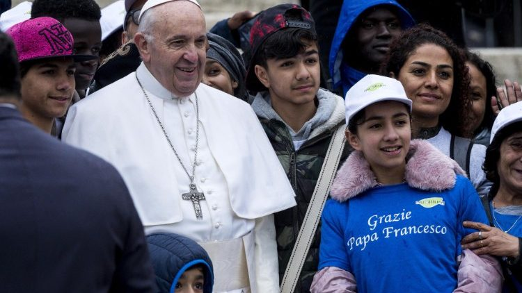 Pope Francis poses at a General Audience with migrants recently-arrived from Libya