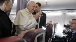 Pope Francis answers questions during the inflight press conference as he returns from Romania