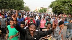 Peaceful protesters attending the 'million men march' protest in Khartoum, Sudan