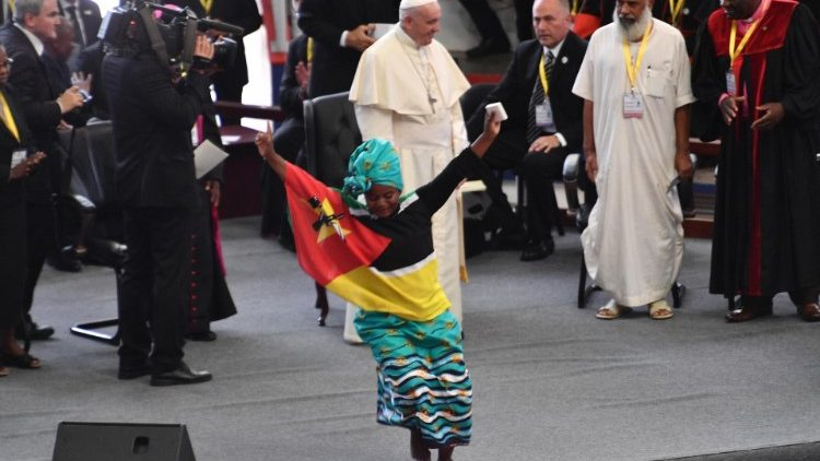 A young girl dances for Pope Francis during the interreligious meeting with the youth