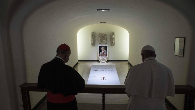 Pope Francis prays in the Caves of the Vatican Basilica