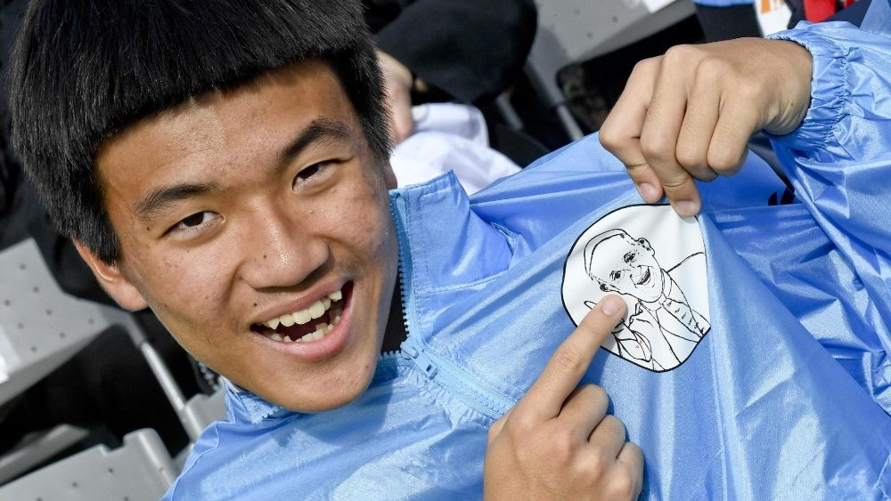A young Japanese person expresses joy for the Pope's presence